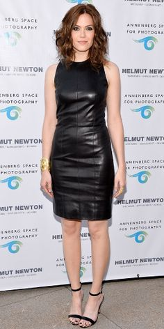 At the Helmut Newton event, Moore glammed up her sexy black leather sheath with gold jewelry and ankle-strap heels.