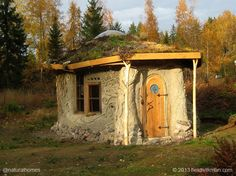 This is Heidi's cottage, 'Elaman Puu', which means Tree of Life. It's built with a variety of natural building techniques with a rubble trench, earthbag stem walls dressed in stone, birch bark damp-proof membrane beneath the straw bales on the northern walls with cob and cordwood to the south and a reciprocal roof on a roundwood frame. All of the materials were harvested locally. See more at www.naturalhomes.org/treeoflife.htm