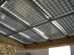 Blurring the Edge of BIPV: Solar Awnings | Home Power Magazine - With hardware and wires hidden, the underside of a well-designed solar awning is aesthetically pleasing.