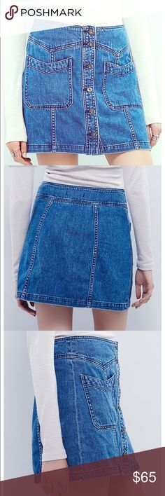 Free People Denim Button Up Skirt High waisted denim skirt that buttons in the front. New this year and never worn, tags on. Free People Skirts Mini