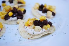 Easiest, tastiest hors d'oeuvre ever award goes to these Tortilla Chips with Black Beans, Corn and Spicy Cilantro Cream.