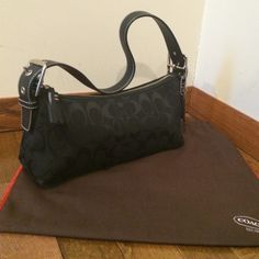 Coach Black Monogram Handbag Canvas exterior with leather and silver hardware strap. In very good condition with minor wear on exterior base corners.  No wear in interior. Has interior zip pocket. Includes dust bag. Authentic. No trades & no pp. Coach Bags Mini Bags