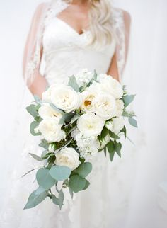 Garden rose and eucalyptus wedding bouquet: Floral Design: Burst And Bloom - http://www.stylemepretty.com/portfolio/burst-and-bloom Hair and Makeup: Melissa Hurkman - http://www.stylemepretty.com/portfolio/melissa-hurkman Photography: Jose Villa Photography - josevillaphoto.com   Read More on SMP: http://www.stylemepretty.com/2017/01/25/the-most-stunning-al-fresco-wedding-by-the-sea/