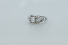 14K white gold ring with .71 ct center princess cut diamond with .39 ctw side diamonds