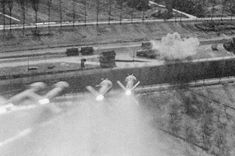 A gun camera picture of a rocket salvo, launched by a Hawker Typhoon towards railway wagons in a siding at Nordhorn, Germany (1945)
