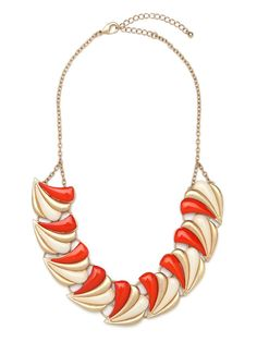 This stunning necklace takes it back to the delightful glamour of the Busby Berkeley era. With its graphic array of Deco shell motifs (in ivory, gold and tangerine), it's all about festive pattern and a hint of showgirl allure.