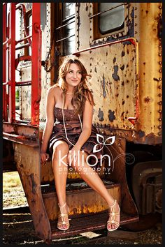 """good idea.  Love the color the train brings.  This chic is overdressed, but I love how they captured her """"smirk"""" and relaxed posture"""