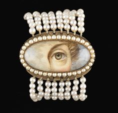 Bracelet with gold clasp surmounted by oval miniature surrounded by seed pearls, ca. 1820. Collection of Dr. and Mrs. David Skier. #lookoflove #eyeminiatures #loverseye