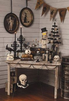 vintage halloween decorations wall pictures wooden table black chandlesticks skulls wall banner - Sophisticated Halloween Decorations
