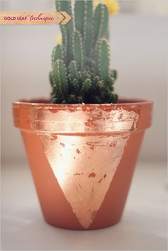 How to gold leaf your own terra cotta pots. #goldleaf #prettythings #howto #makeityourself http://www.weddingchicks.com/2013/10/31/diy-terra-cotta-pots/