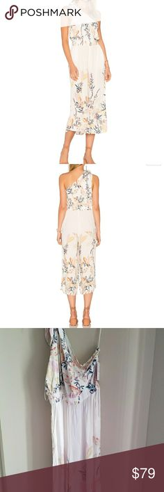 NWOT Free People island time jumpsuit So effortless one piece featuring an asymmetrical, off-shoulder neckline, a fitted waist and a cute cropped shape at the relaxed leg.  Elastic band at the waist Adjustable tie detail at the shoulder Hidden side pockets  New without tag. Never been worn.  Great for a cruise, vacation, or special occasion! Free People Pants Jumpsuits & Rompers