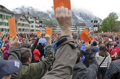 All the citizens of canton Glarus have a vote at the Landsgemeinde, witnessed this year by the Austrian vice chancellor (Keystone)