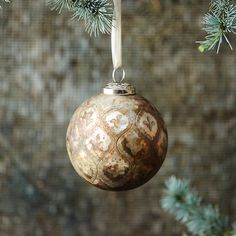 "An antiqued metal finish tops this simple glass globe ornament.- Glass, metal cap- Indoor use only- Hanging loop: 0.6""- Imported4.8""H, 3.8"" diameter"