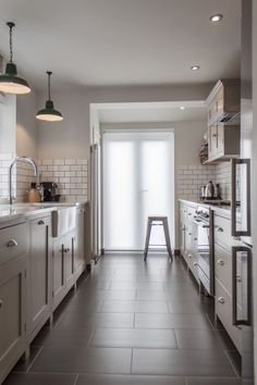 I like the light colors that were picked galley kitchen - narrow width, door at end and store cupboard