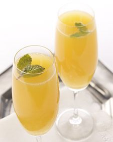 Menning Mimosa   Ingredients    6 tablespoons freshly squeezed orange juice  2 tablespoons freshly squeezed lemon juice  2 tablespoons orange flavored liqueur, such as Grand Marnier  Prosecco, chilled  Fresh mint leaf  Directions    In a Champagne flute, mix together orange juice, lemon juice, and liqueur. Fill with Prosecco. Garnish with mint leaf and serve immediately.