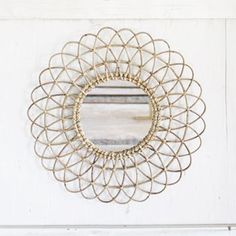 DIY inspiration for Scroll Saw. Will have to make a pattern once I get the mirror.  Swirling Ribbon Wall Mirror | dotandbo.com