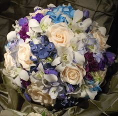 Bridal bouquet made with orchids and roses. #flowers #wedding