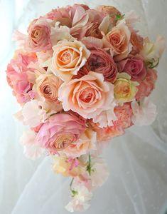 ブーケ オーバル Jスィーティとラナンキュラスのオレンジ : 一会 ウエディングの花