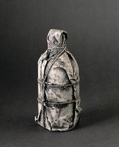 Wrapped Bottle 1958 8 x x cm) by Christo and Jeanne-Claude. Medium: Fabric, rope, lacquer, paint, sand and a bottle; Yves Klein, Vanitas, Christo Et Jeanne Claude, Christo Art, Nouveau Realisme, Instalation Art, Still Life Drawing, A Level Art, Thing 1