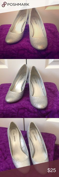 Silver sparkle heels The perfect heel to last you through the night without any back pain! They are completely covered in sparkles and they were only worn 2 times. On the right shoe, there is a small darker spot on the heel. It's in a good spot where it's not noticeable. Call It Spring Shoes Heels