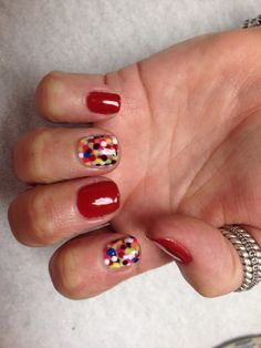 Red with rainbow poke a dots accent nails  Oasis Salon and Spa Mill Hall Pa (570)726-6565