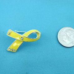 Broach ~ Troop Awareness/Yellow Ribbon by Awareness. $4.50. BROACH ~ YELLOW RIBBON ~ TROOP AWARENESS. ~  [PLEASE NOTE: Awareness fashion jewelry is mass produced and may have slight imperfections.] *********************************************In addition to Troop Awareness, The Yellow Ribbon is also used for the following awareness causes: Adenosarcoma - Adoptive Parents - Amber Alert - Bladder Cancer - Boycott Aruba - Canadian Cancer Society - Carbon Monoxide Poisoning...