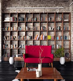 Brick accent wall, bookshelves, and comfy focal chair