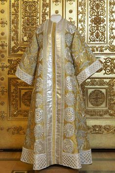 Empress Alexandra Feodorovna's Masquerade Dress for the Costume Ball at the Winter Palace, 1903 : She went as Tsarina Maria Iljinitsjna, wearing a gown and robe of gold brocade, silver thread, sequins, artificial pearls, rhinestones, glass; a gold brocade crown, decorated with artificial pearls; and chamois shoes with brocade, silver thread, sequins, glass.