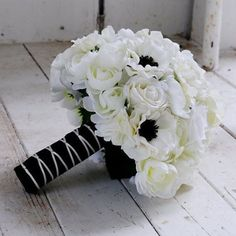 Loving this classic black and white beauty by the amazing @blueeyesbridal! A show stopper for sure! #afloral #fauxflowers #weddingbouquet #littleblackbouquet #weddingflowers #blackandwhite #blackandwhitewedding