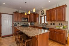 Traditional Kitchen with High ceiling, Giallo Napolean Granite Countertop, MS International, Hardwood floors, Flush, L-shaped