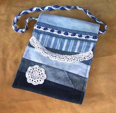 upcycled denim purse with crochet added to it