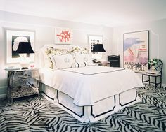 Hollywood Regency Bedroom: Zebra-print carpeting and an abundance of art in a black-and-white bedroom.