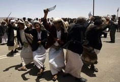 Villagers dance during a ceremony for the opening of housing units in the al-Dhafir village west of Sanaa, Yemen on May 24, 2009. The houses were built by Saudi Prince al-Waleed bin Talal for victims of the December 28, 2005 landslide in al-Dhafir. The landslide killed 65 people and destroyed 27 of the village's 31 houses. (REUTERS/Khaled Abdullah) #
