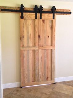 Custom barn doors from a milled pine tree by JB Precision Carpentry Inc.