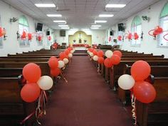 The Altar Guild decorated the church for Pentecost, with red and gold balloons and ribbons. We had lovely red and white roses at the altar, too!