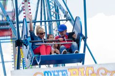 Day 5 - Pastor Jim and Lori riding the Ferris Wheel with Olivia!