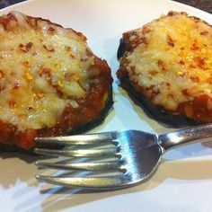 Roasted Eggplant Parmesan: Slice an eggplant and place on a baking sheet. Then spray tops with olive oil, lightly sprinkle on Kosher salt, and roast in oven at 400 degrees for 20 minutes. Then, top each roasted eggplant slice with marinara sauce, shredded part-skim cheese (tonight I used Sargento 4-cheese Italian), some grated parmesan cheese, oregano, and crushed red pepper. Pop back in oven for about 5-10 minutes until the cheese is hot and bubbly. Only 70 calories per slice!