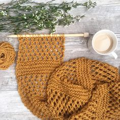 Today, I'd like to share a simple pattern with you for an easy knit scarf that's perfect to wear in warmer weather. Of course, it could be used in the winter too, but the open stitch-work makes it suitable for spring and summer. The mesh that is created in this project is a favorite of mine as it's really easy to knit and it creates a really beautiful texture, don't you think? It reminds me of the look of honeycombs and the color of the yarn also reminds me a bit of honey, hen...