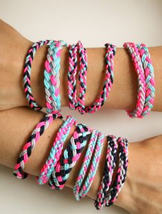 DIY Easy Braided Friendship Bracelet Tutorials from The Purl Bee here.For pages more of summer friendship bracelets go here.There are several tutorials in this post for the following bracelets: Doubled Basic Braid Single and Double 5 Strand Braid 5 Strand Dovetail Braid 7 Strand Braid