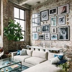 I LOVE THIS ONE, and you have a grey couch and exposed brick in the kitchen.