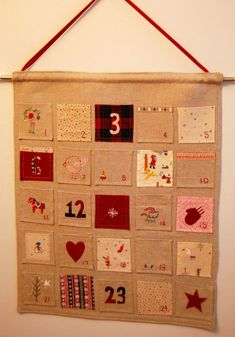 rustic advent calendar with emrodiery and applique from greenjello.typepade.com