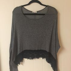 """🐷Crochet Trim Top Cute long sleeve gray top with black crochet lace trim in small. Can fit medium too. Bust 27"""" across, 24"""" length. Fabric semi sheer can wear cami underneath. Fabric 96% rayon, 4% spandex. Happy Poshing 🎀 Sarah la Tops Blouses"""