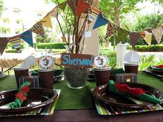 already had a Robin Hood party, but I like could still use ideas with the table setting and fabric banner for future themes