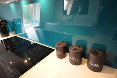 The teal splashback colour looks really rich under our warm toned spotlights.