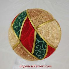 Country Christmas Japanese Kimekomi Ball.    This is a kimekomi type ball, with fabric shapes tucked down into the ball and the seams covered with satin cord. It is a 3 diameter ball.    ******************************  The Artist  Barbara B. Suess, certified Master/Instructor (Shihan) by the Japan Temari Association, is the author of Japanese Temari and Temari Techniques. She also co-authored Japanese Kimekomi, Fast, Fun, and Fabulous Fabric Handballs, with Kathy Hewitt. All are publishe...