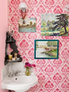 love how the paintings pop against the pink walls- and dig the tiny sink #stylecure