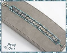 Teal and Grey Tila Bead Bracelet with Herringbone Stitched Delica Seed Beads in Teal and Steel Grey by Morningreen on Etsy https://www.etsy.com/listing/202965609/teal-and-grey-tila-bead-bracelet-with