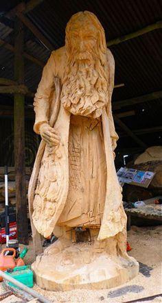 Noah, among the wood carvings by artist Simon Hedger.