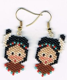 Here is a lovely pair of Little Hand Beaded Indian Boy dangling earrings. They measure 3/4 x 1 1/4. These were designed by Linda K Hampton and beaded