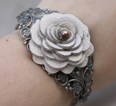 Filigree cuff with leather rose, from Leatherblossoms on Etsy